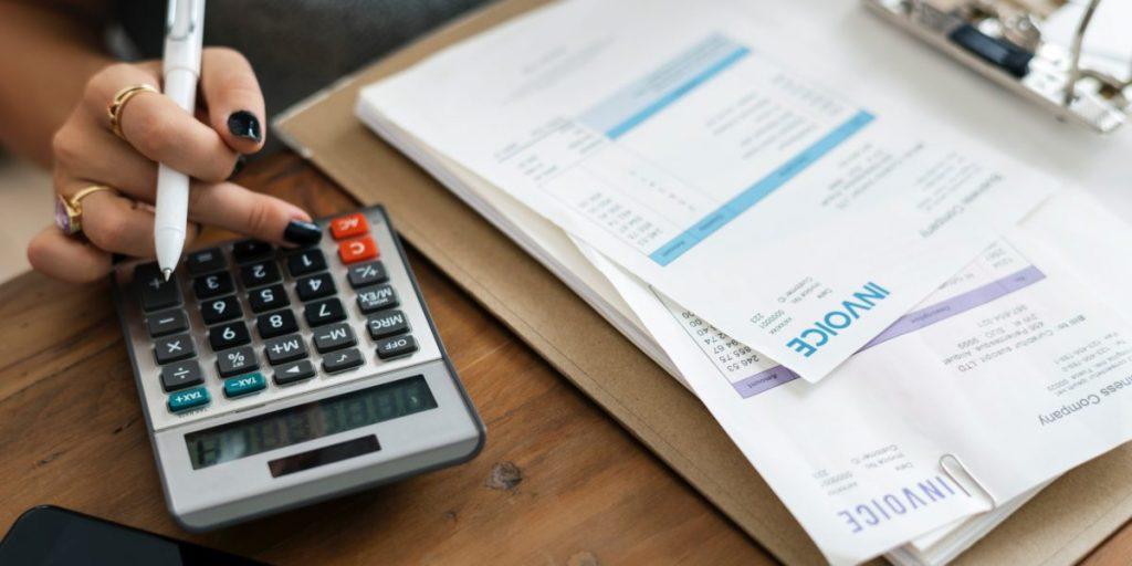 woman uses calculator